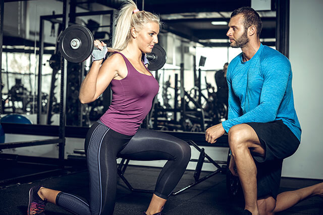 Lunge exercise with personal trainer